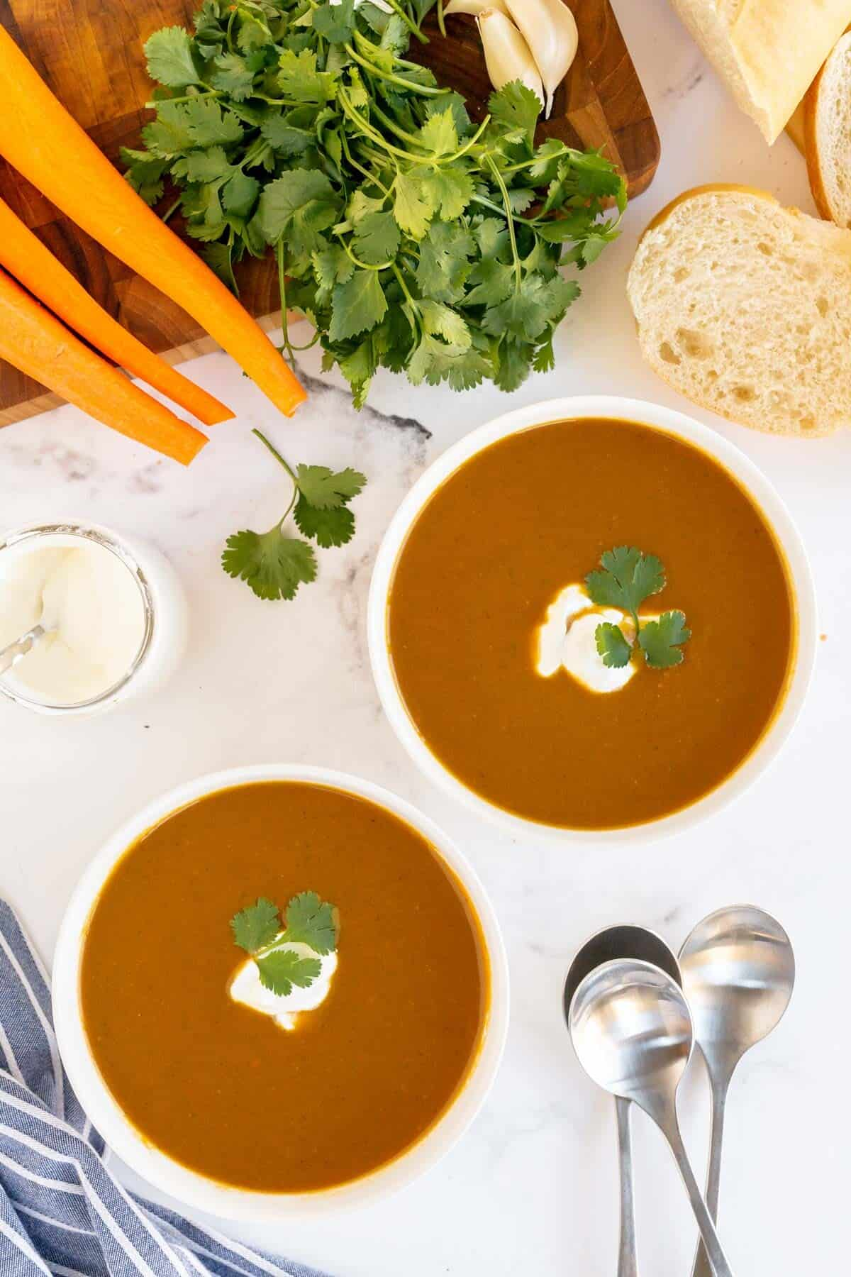overhead of carrot soup in bowls