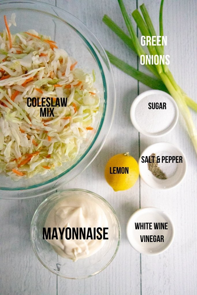 homemade coleslaw ingredients on a white board
