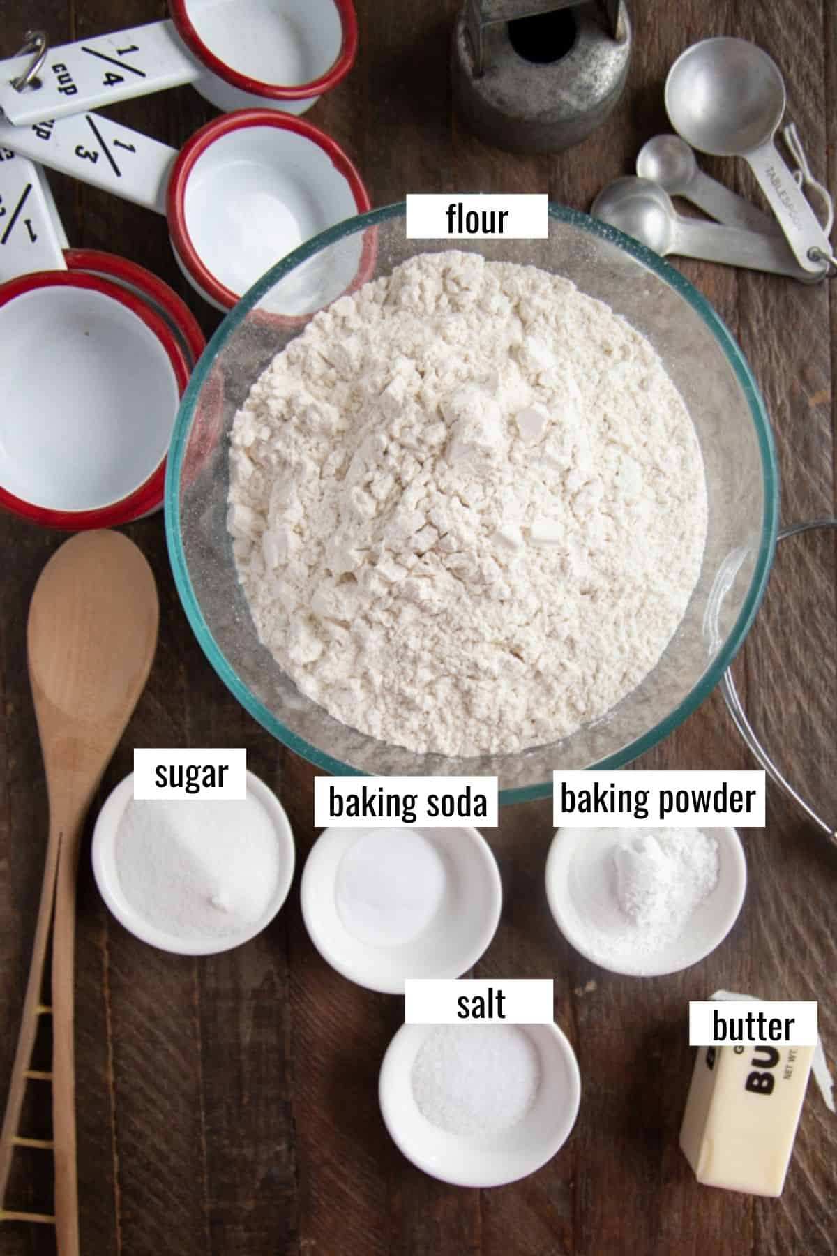 ingredients for making homemade bisquick laid out labeled