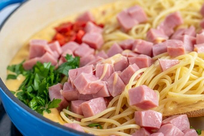 ham tetrazzini in a blue dutch oven