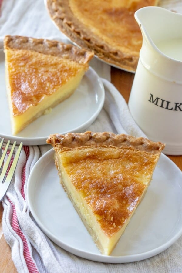 Buttermilk pie on a plate with a white and red napkin