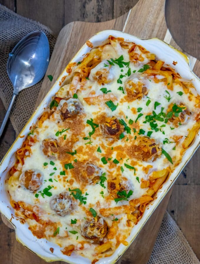 4 Ingredient Meatball Casserole on a wooden board with a