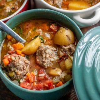 albondigas soup in a teal crock