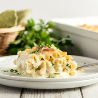 Florentine Chicken Lasagna Roll Ups on a plate with a fork