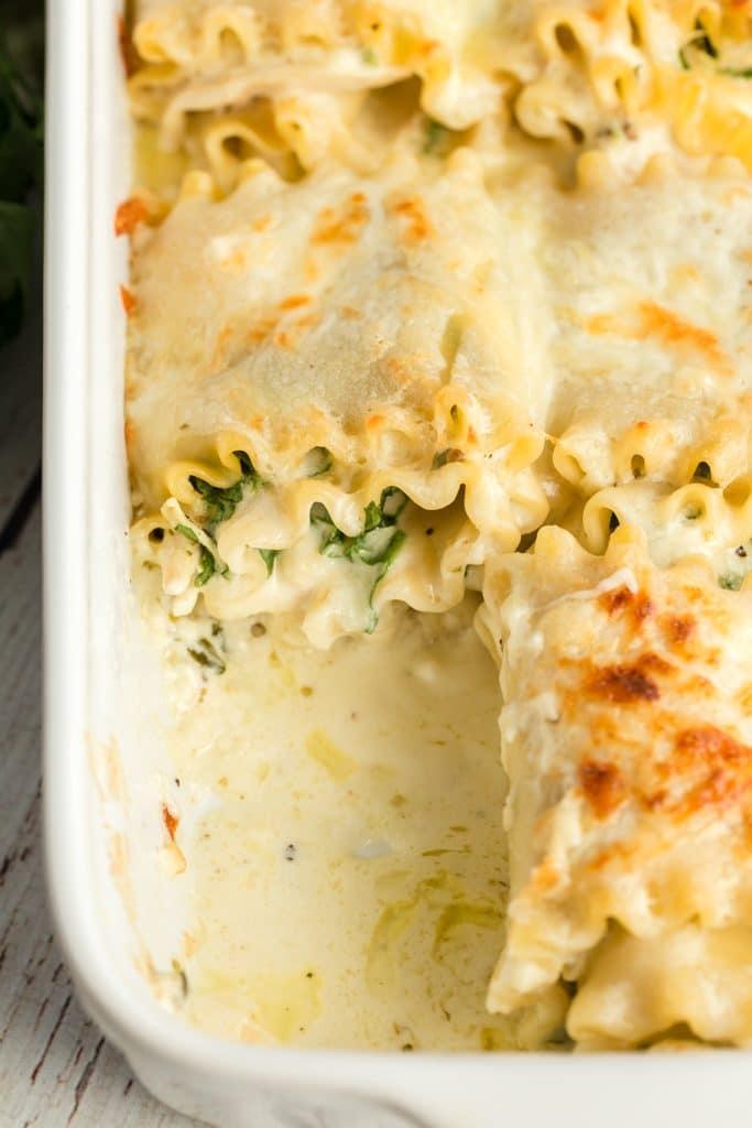 Florentine Chicken Lasagna Rolls in a white baking dish
