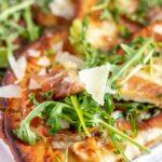 flatbread pizza on white platter