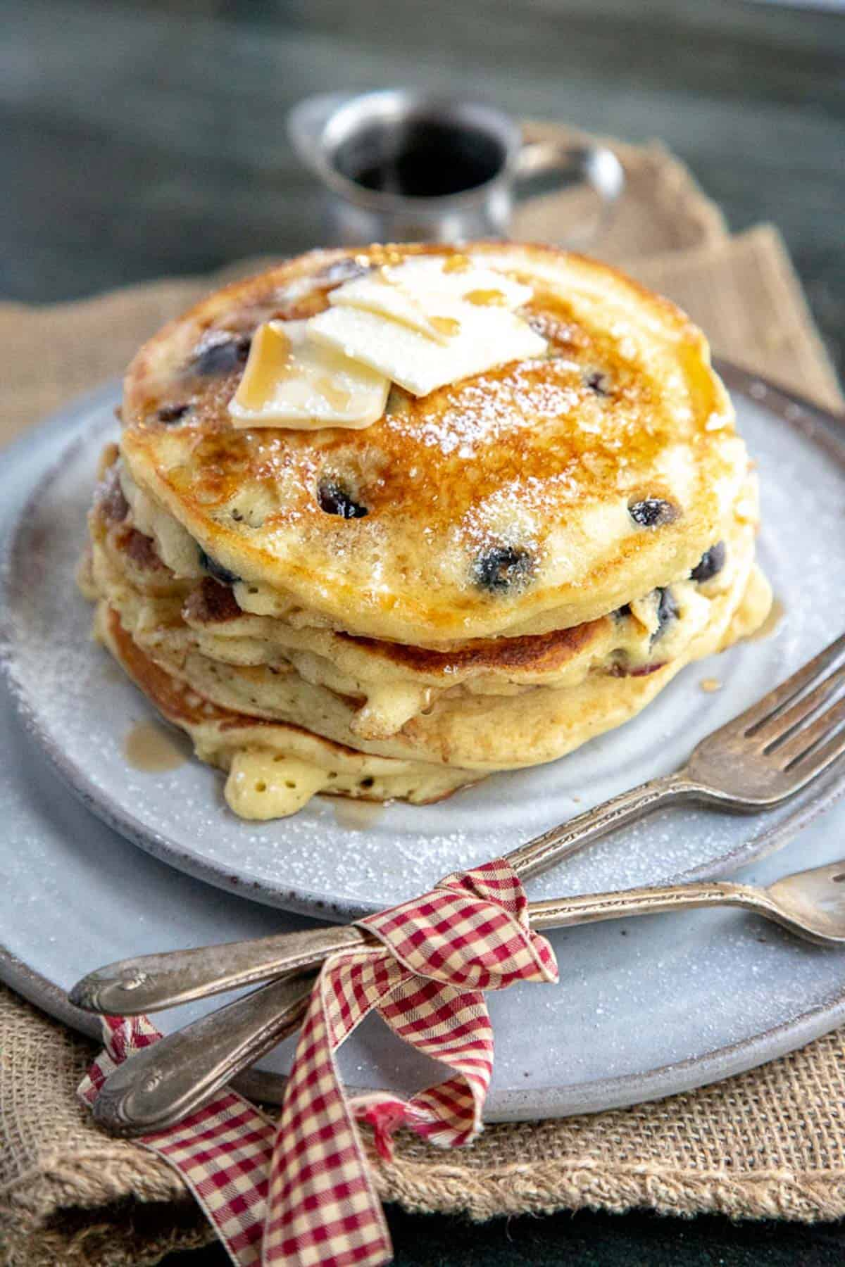 blueberry pancakes on a grey plate