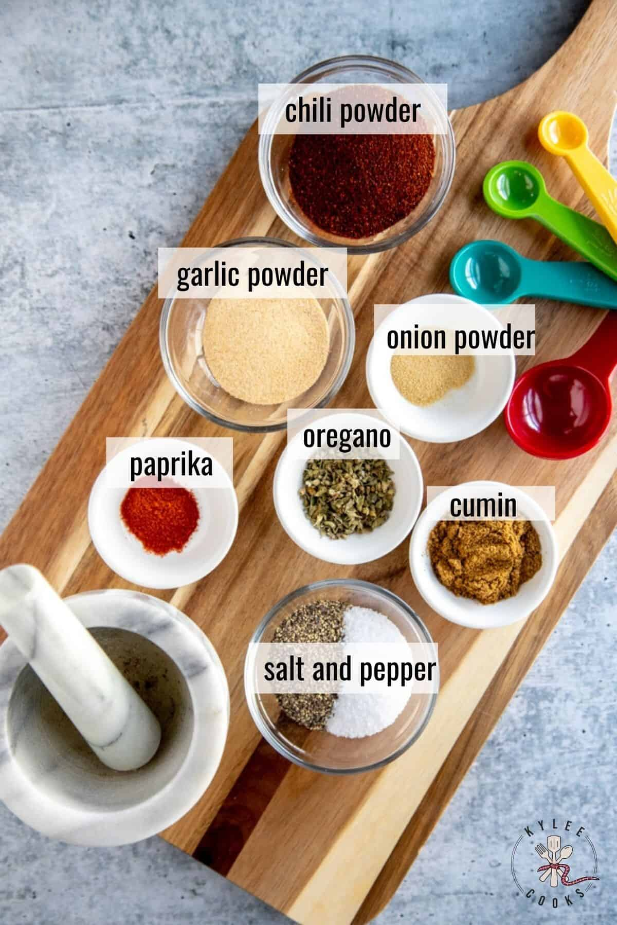 ingredients for taco seasoning laid out and labeled