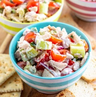 tuna salad in three bowls with crackers