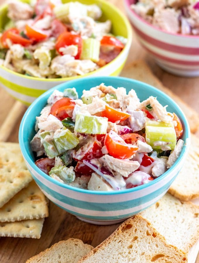 tuna salad in three bowls with crackers
