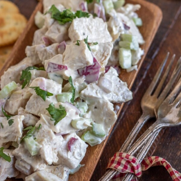 chicken salad on a wooden plate