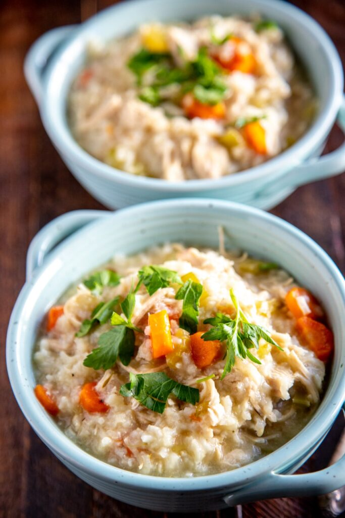 instant pot chicken and rice in two teal bowls