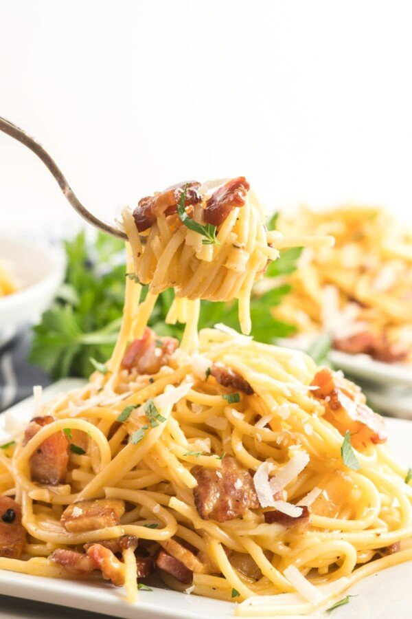 spaghetti carbonara twirled around a fork