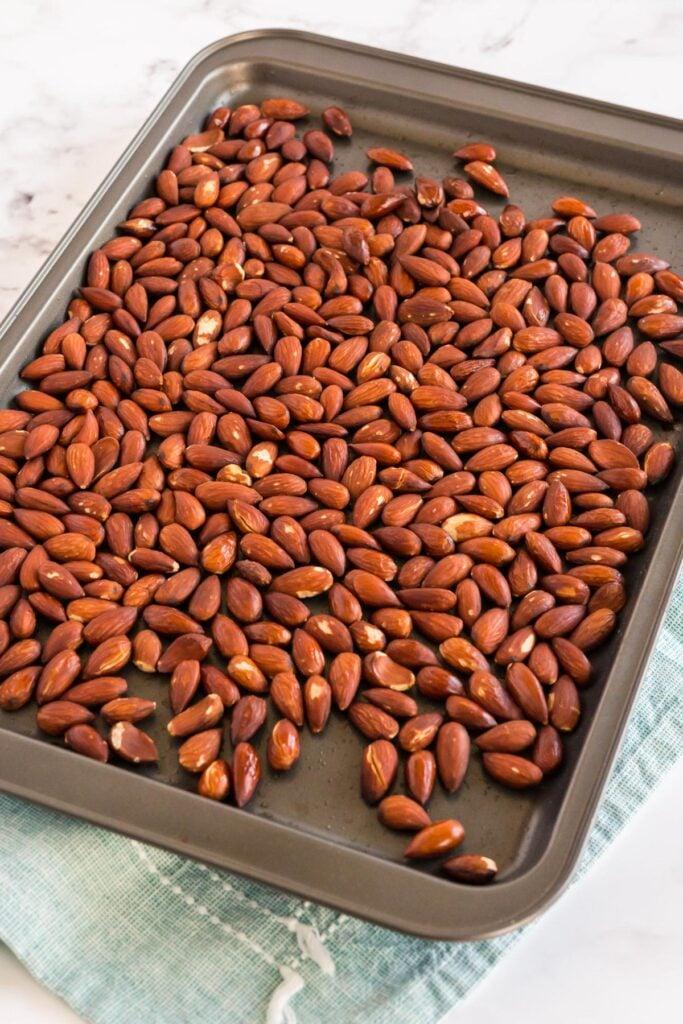 raw almonds on a baking sheet