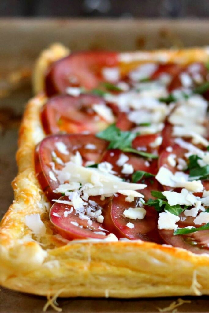 fresh tomato tart on a baking pan