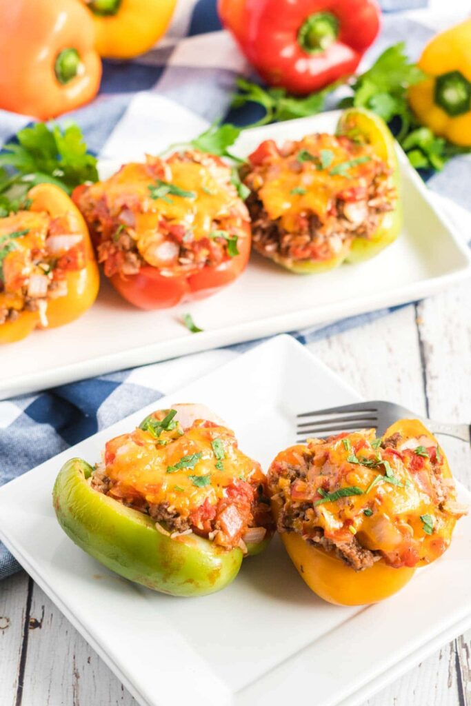 Stuffed peppers on a white plate with a fork