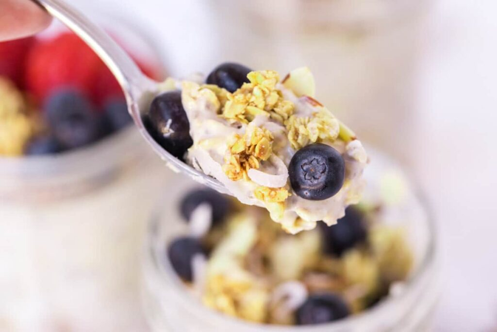 spoonful of overnight oats with berries