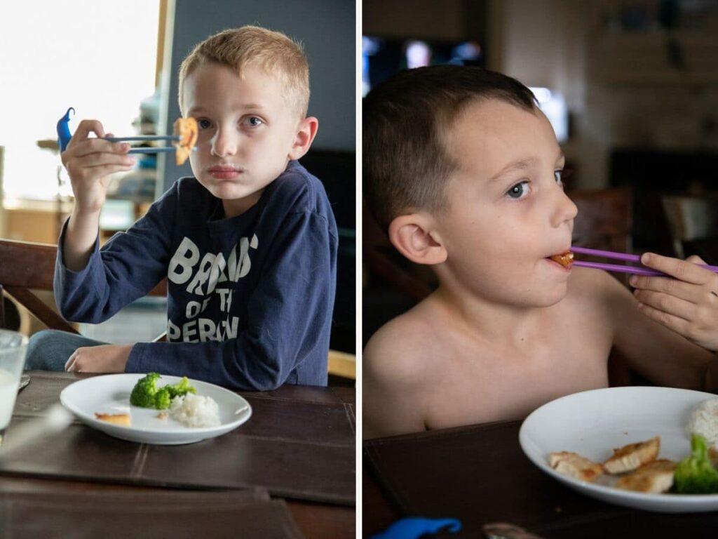2 little boys using chopsticks