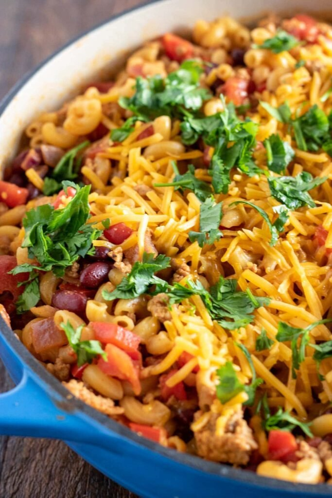 Turkey Chili Mac & Cheese in a blue skillet