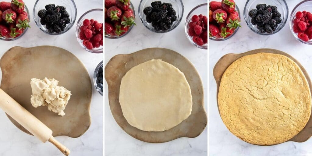 spreading cookie dough out on a pizza stone with berries in the background