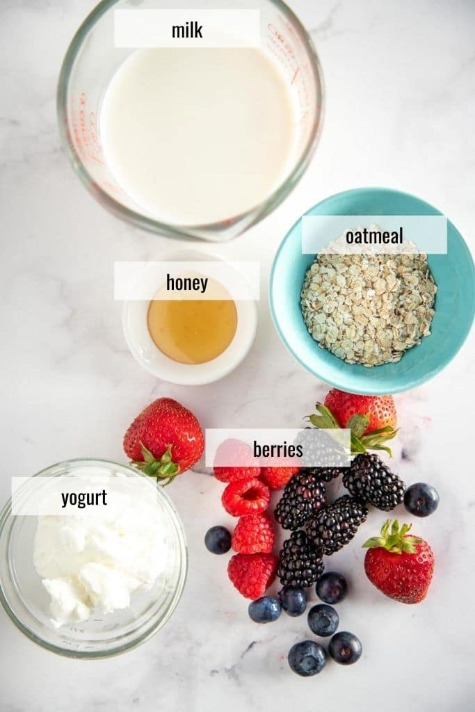 ingredients to make an oatmeal smoothie laid out and labeled