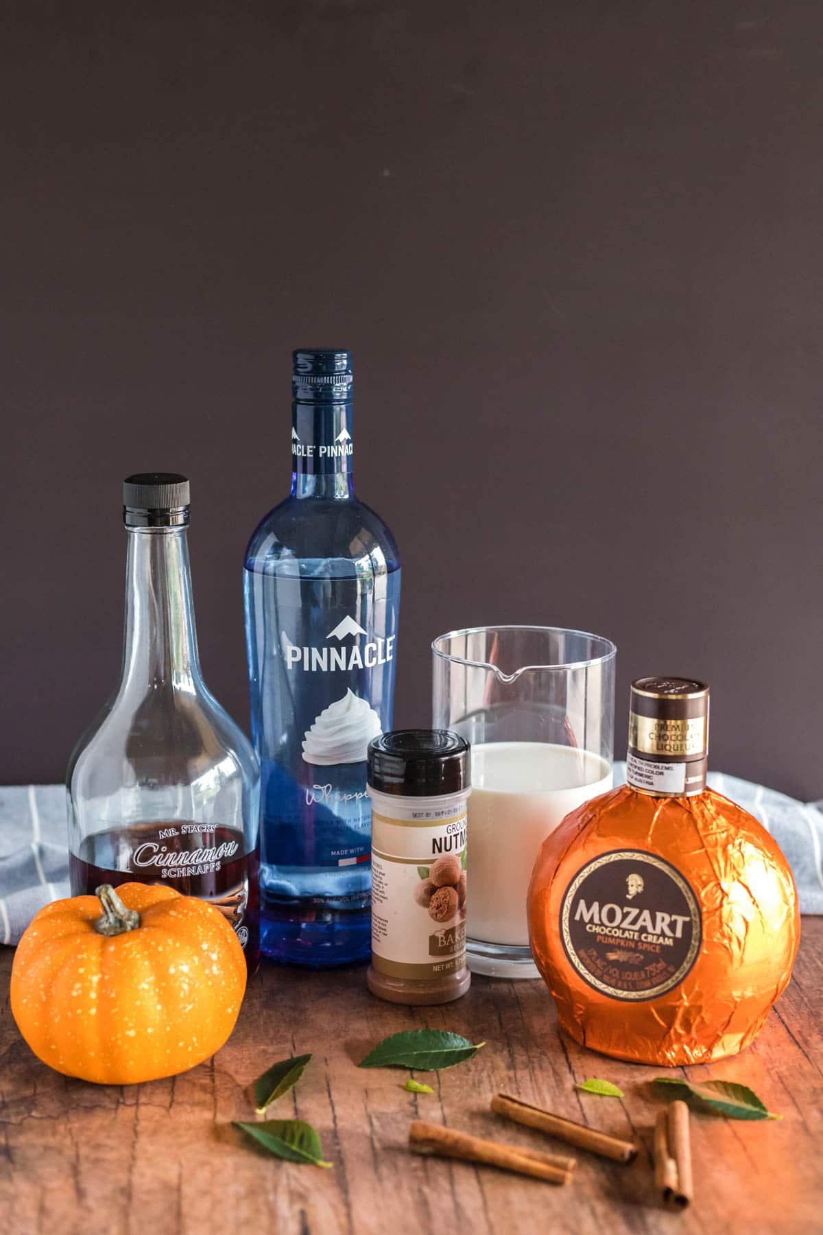 liquor bottles ready to make pumpkin cocktails