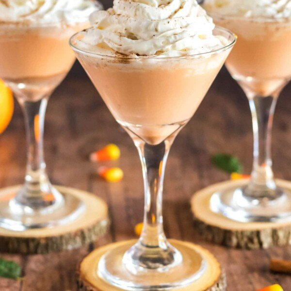 pumpkin drink in a martini glass with whipped cream
