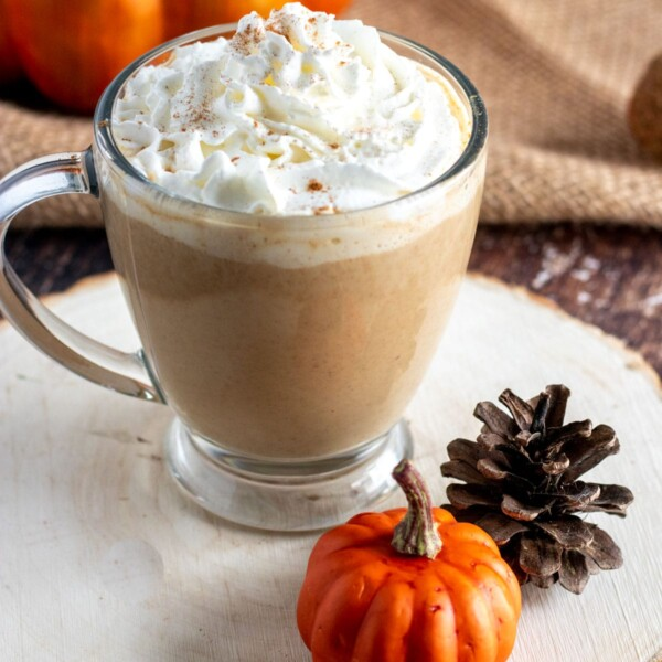 pumpkin spice latte in a glass cup with whipped cream