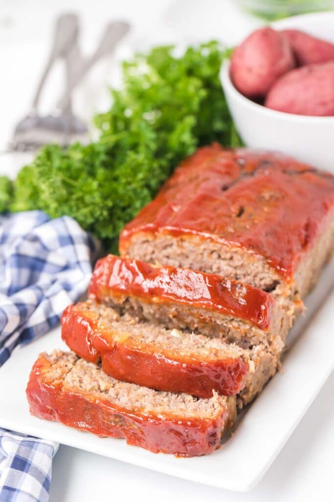meatloaf slices on a white plate