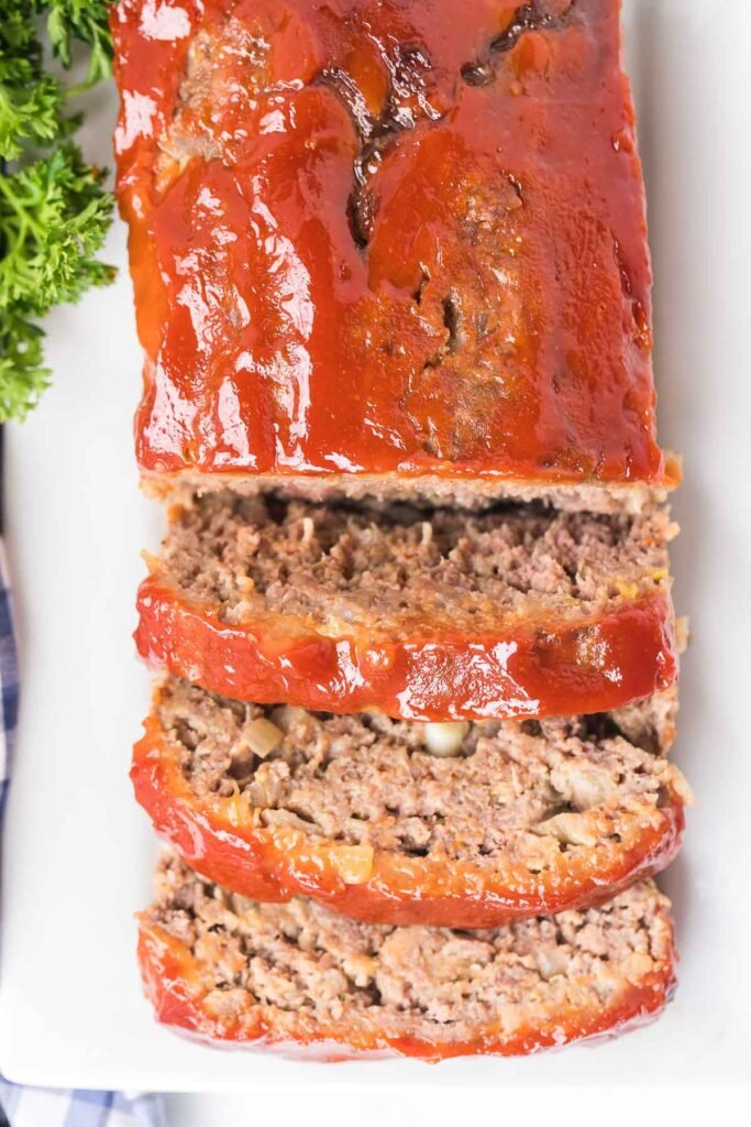 overhead shot of meatloaf with three slices cut