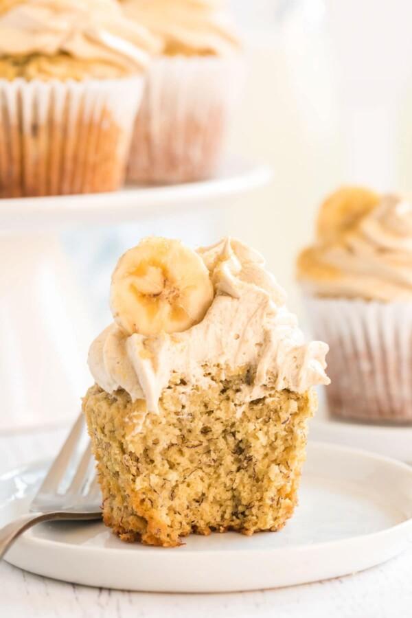 banana cupcake cut open with slice of banana