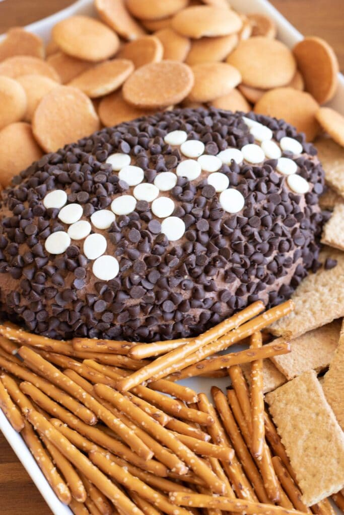 football shaped cheese ball with dippers