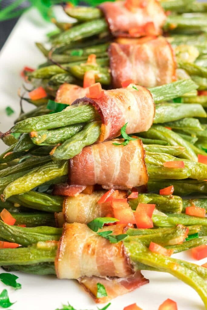 green bean bundles on a white platter