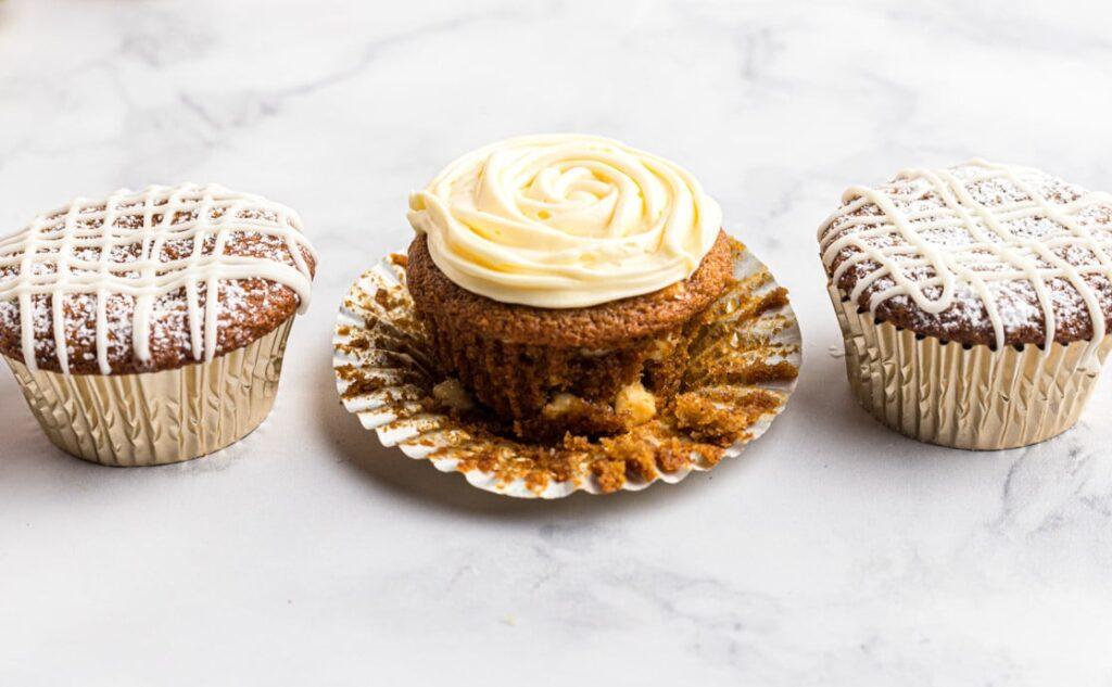 3 pumpkin muffins on a marble board