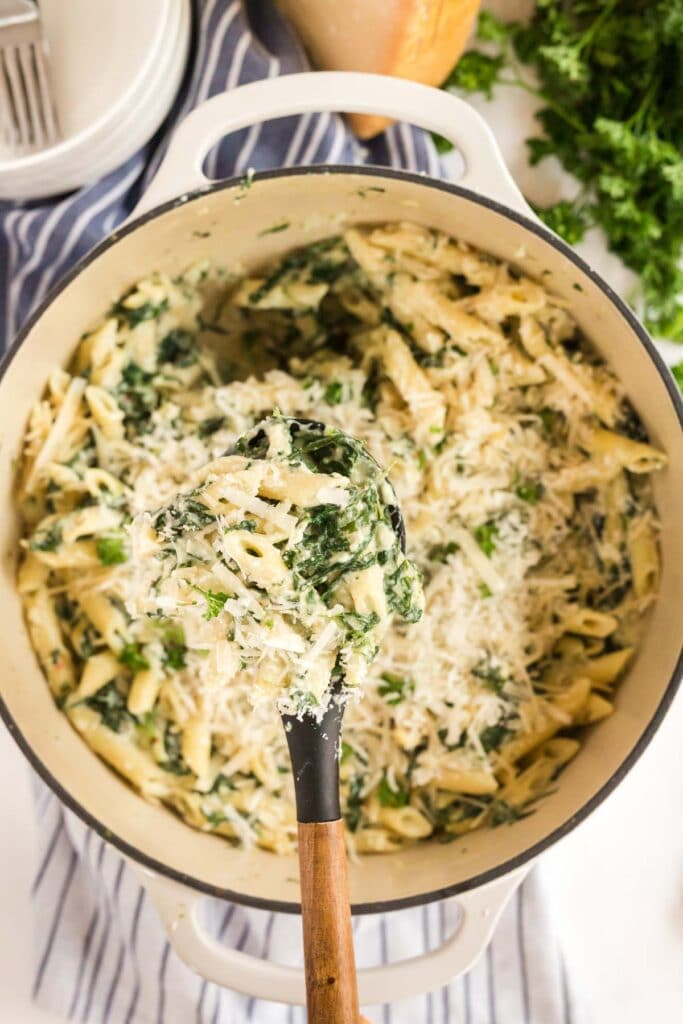 florentine pasta in a dutch oven with a spoon out
