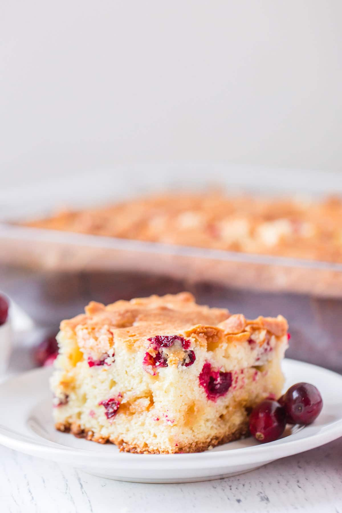 cranberry cake on a white plate