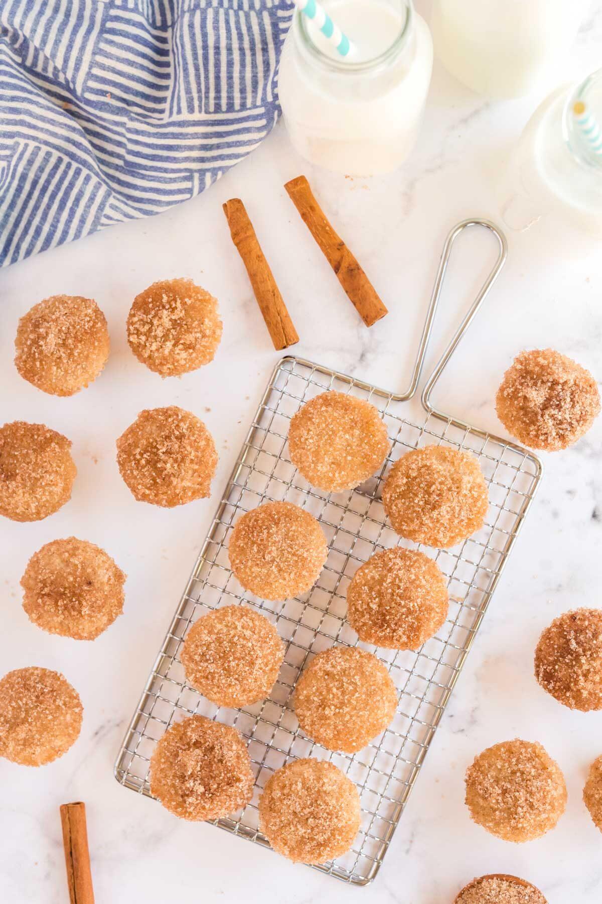 cinnamon sugar donut muffins on a rack