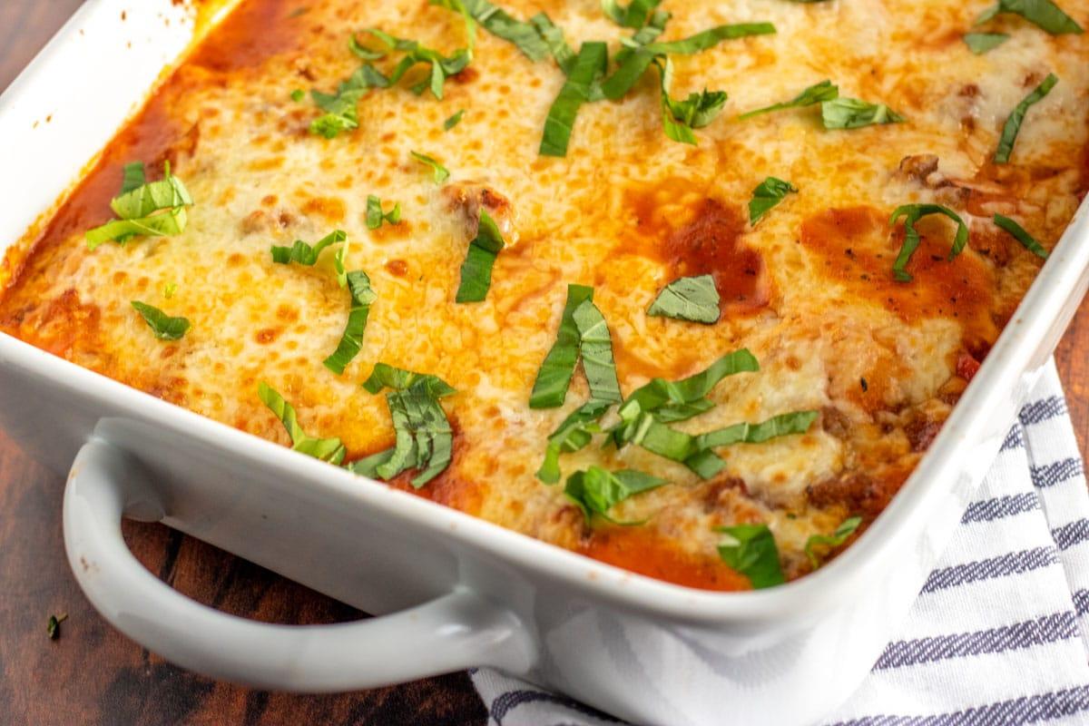 ravioli lasagna in a white casserole dish