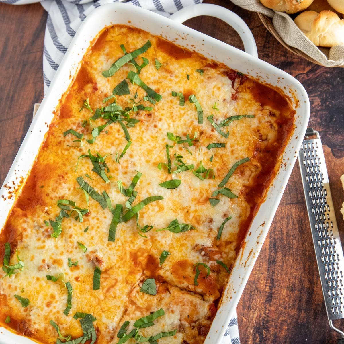 overhead shot of ravioli lasagna in a white casserole dish