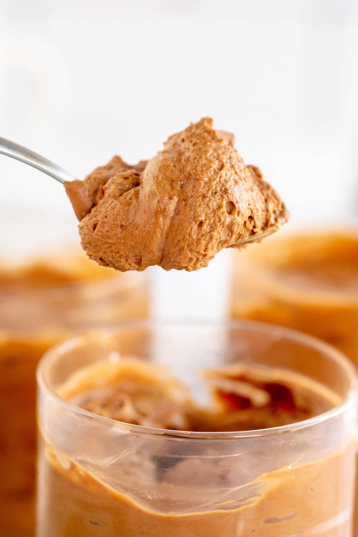 coffee mousse on a spoon after refrigeration