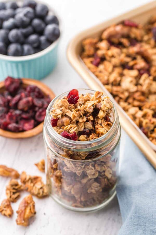 homemade granola in a jar with berries
