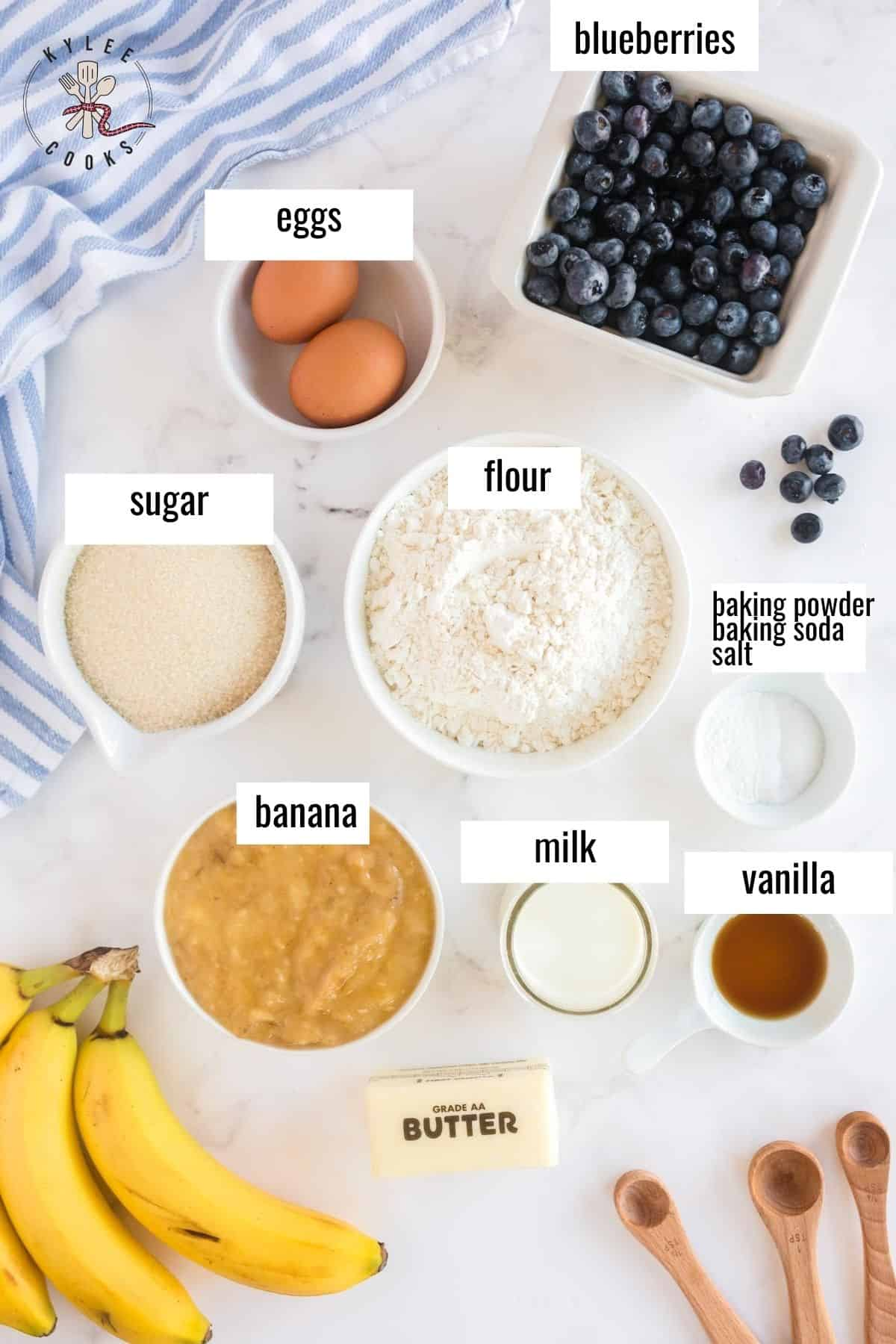 ingredients to make blueberry banana bread laid out and labeled