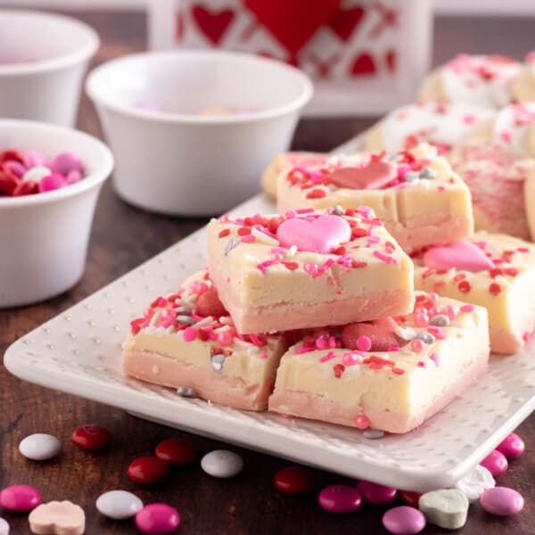 pink and white fudge on a white platter
