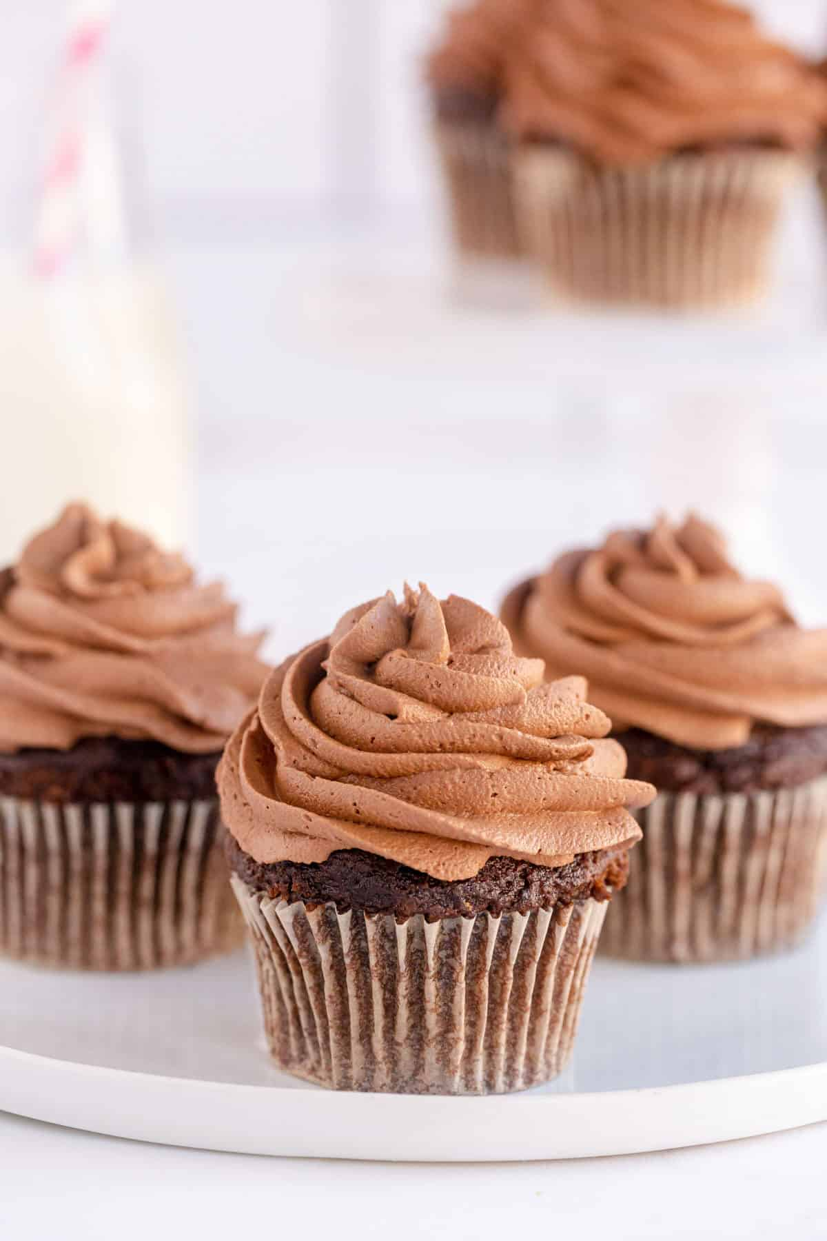 3 chocolate cupcakes with frosting