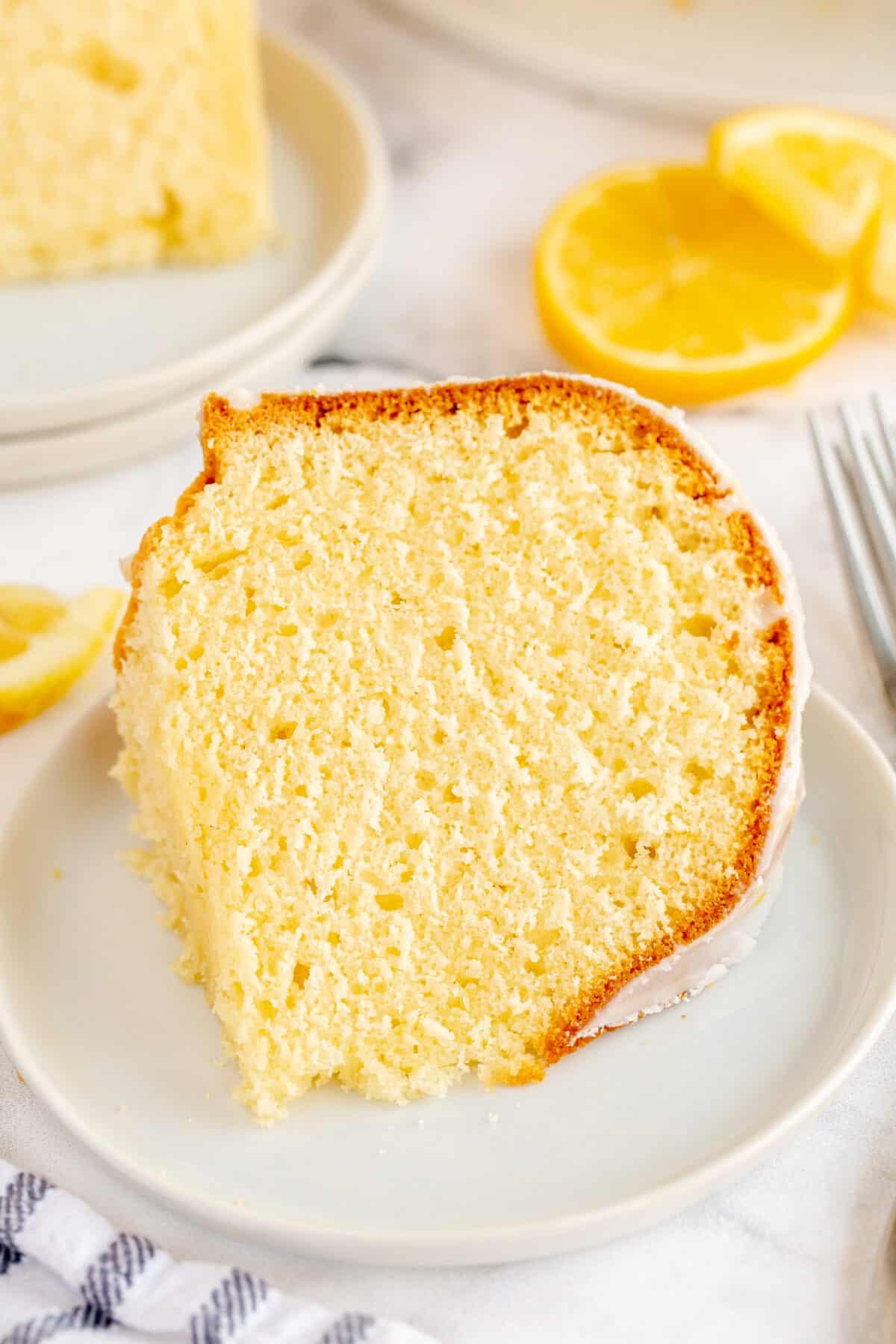 close up of a slice of lemon cake