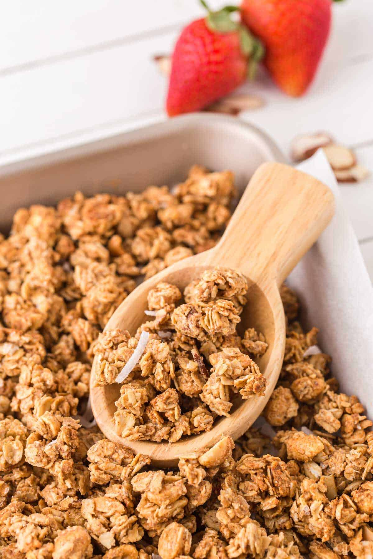 peanut butter granola on a wooden spoon