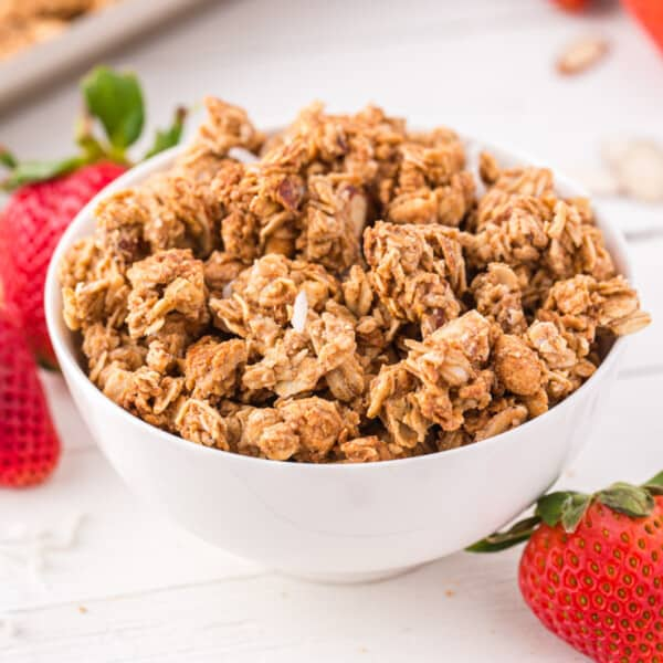 peanut butter granola in a bowl with strawberries