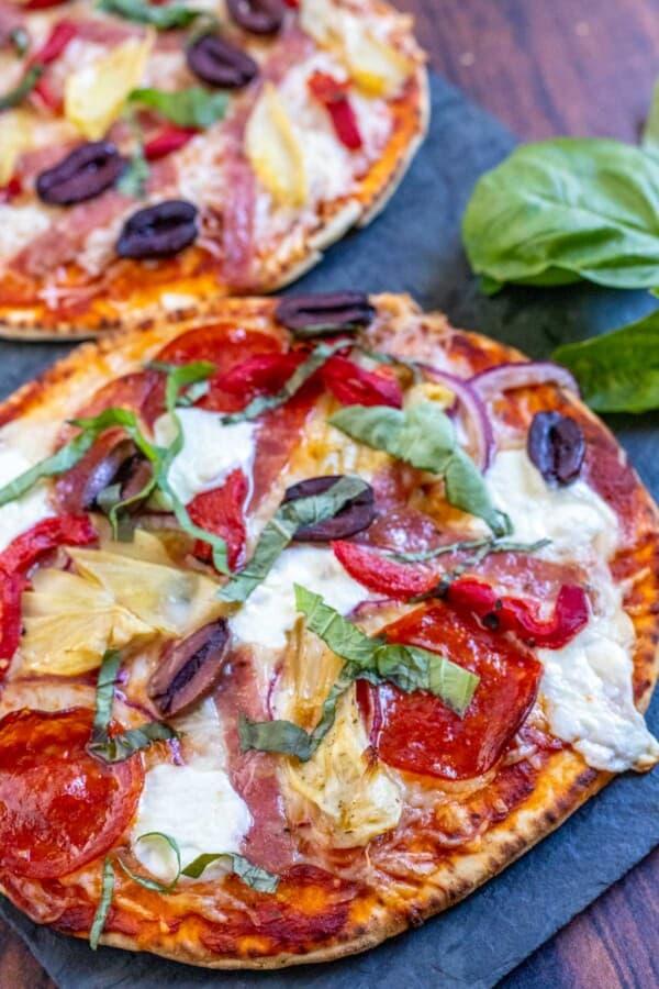 flatbread pizza on a slate board