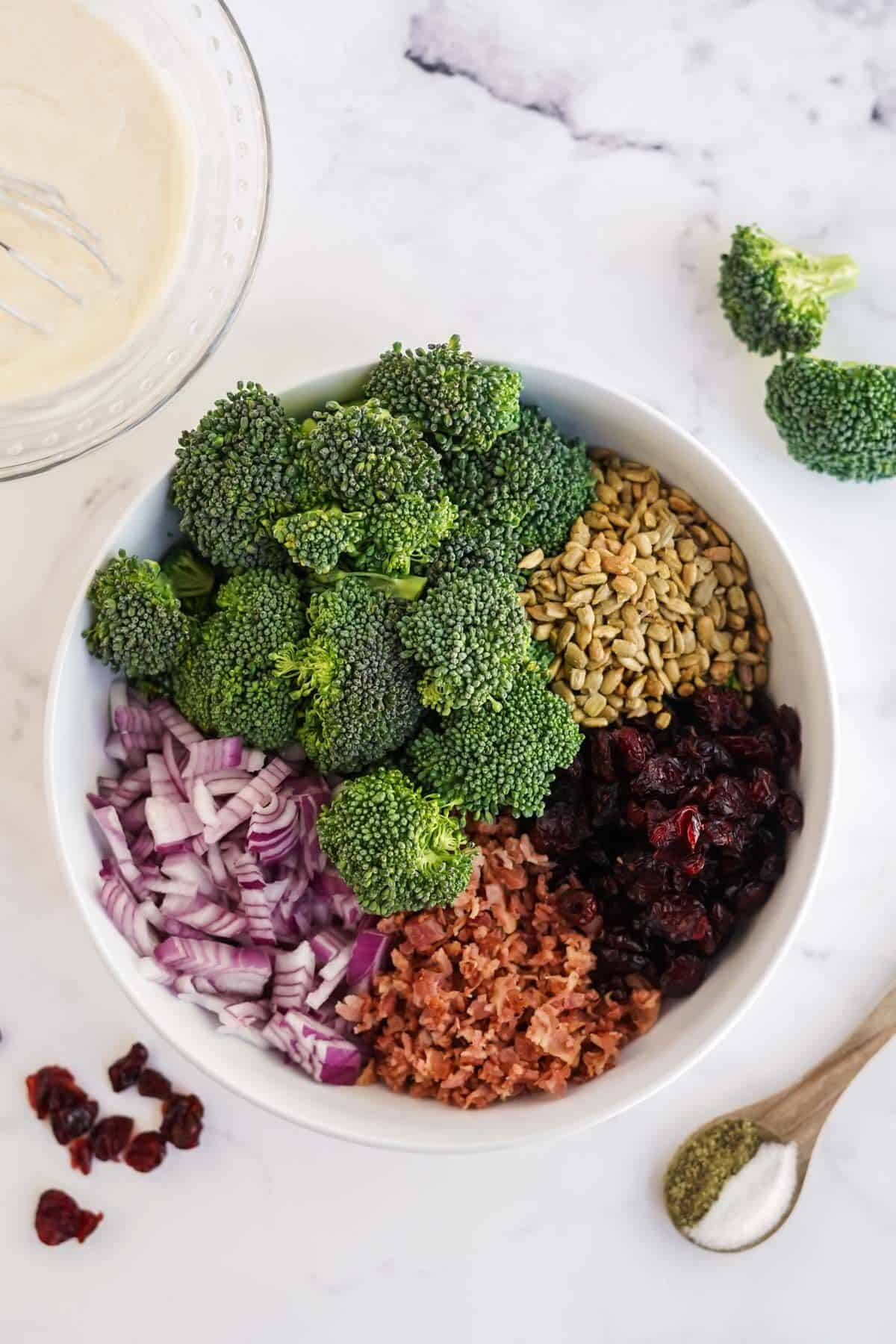 all ingredients for broccoli salad in a bowl before mixing