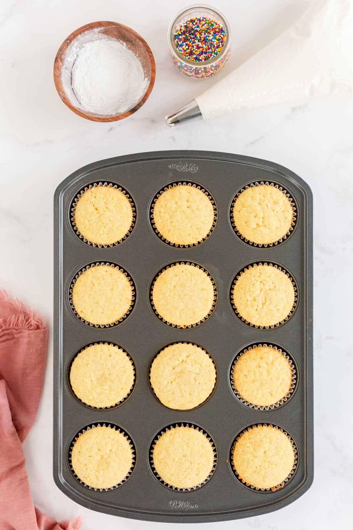baked vanilla cupcakes in a pan